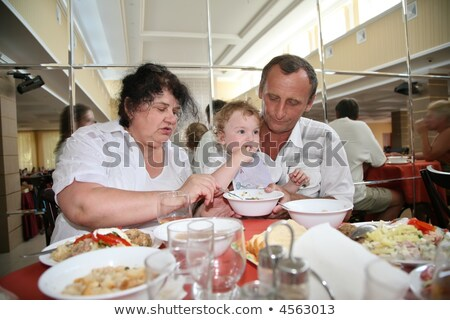 Grandmother with grandfather nourish child in canteen one Stock photo © Paha_L