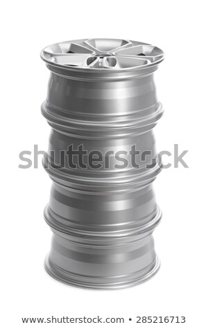 Set in a stack of steel alloy car rims. Stock photo © RuslanOmega