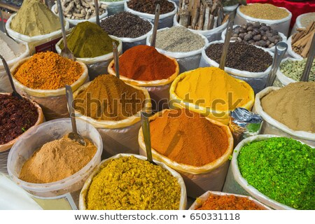 Pepper and other spices at a market Stock photo © elxeneize
