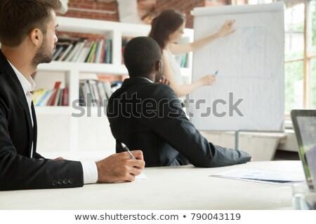 Fókuszált férfi hallgat készít jegyzetek bemutató Stock fotó © deandrobot