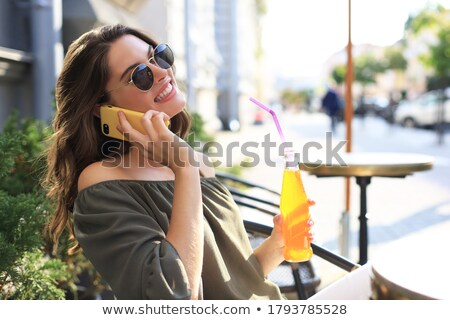 Seductive attactive young business woman talking on mobile phone  Stock photo © deandrobot