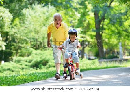 портрет счастливая семья дедушка и бабушка мальчика футбольным мячом время Сток-фото © diego_cervo