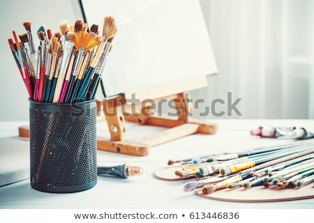 Easel and painting supplies Stock photo © Filata