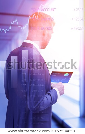 Businessman checking a pie graph on a tablet Stock photo © Kzenon