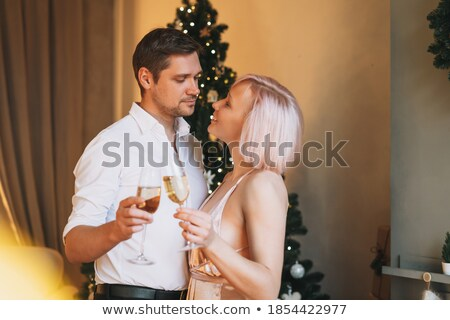 Party, drinks. Beautiful elegant woman in evening dress with cha Stock photo © Victoria_Andreas