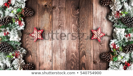 merry christmas frame with green pine colorful baubles knots with berries and stars stock photo © davidarts