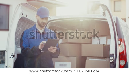 portrait of courier smiling at the camera stock photo © monkey_business