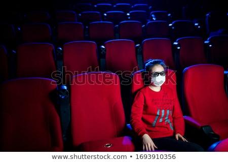 Portrait of woman sitting in movie theatre Stock photo © wavebreak_media