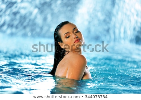 Mulher cachoeira em pé água Foto stock © Anna_Om