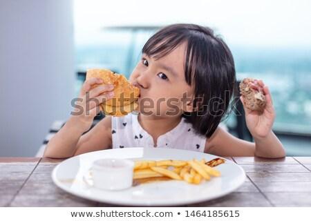 Criança alimentação insalubre dieta vista lateral gordura Foto stock © Lightsource
