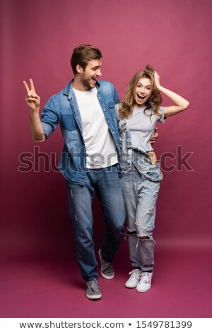 happy laughing casual couple making the victory sign stock photo © feedough