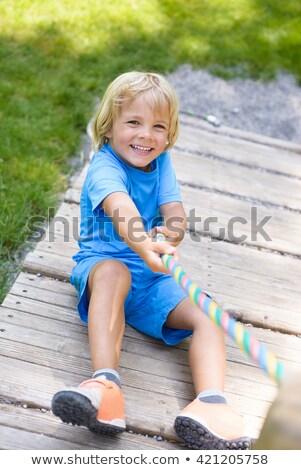 Boldog kicsi fiú élvezi hinta hideg Stock fotó © elly_l