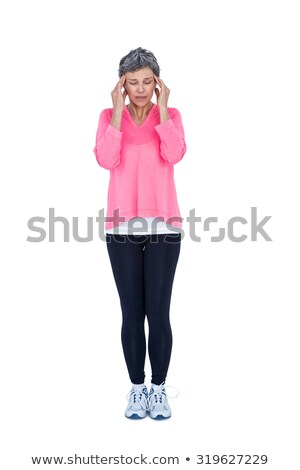 Full length of mature woman suffering from headache Stock photo © wavebreak_media