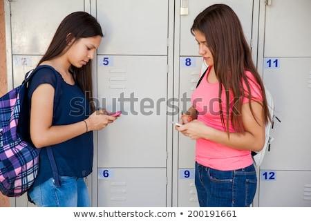 Iskolás lány sms chat osztály férfi technológia oktatás Stock fotó © IS2