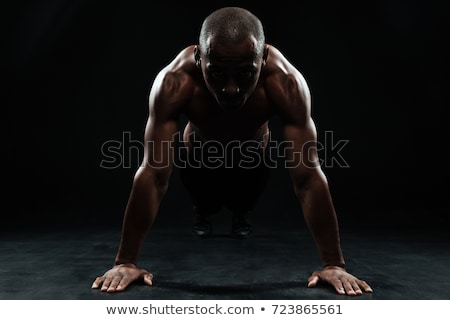 Portrait of youg afro american sports man doing pushup exercise Stock photo © deandrobot