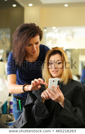 Woman and hair stylist on phones Stock photo © IS2