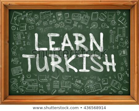 Green Chalkboard with Hand Drawn Learn Turkish. Stock photo © tashatuvango