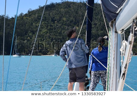 Concentrating couple sailing yacht Stock photo © IS2