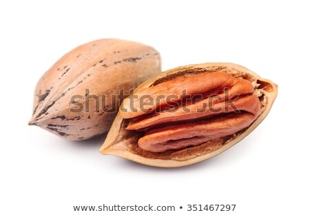 Raw pecans with shell on white background Stock photo © DenisMArt