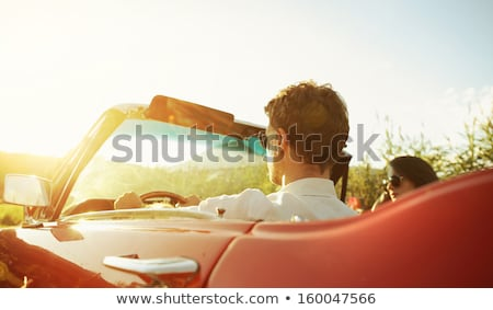 Young man driving convertible car Stock photo © IS2