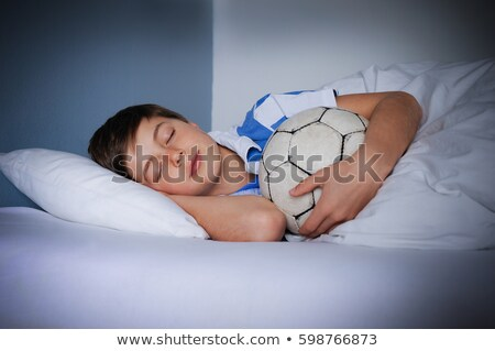 Boy sleeping with football as pillow Stock photo © IS2