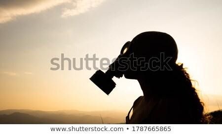 Kadın gaz maskesi ekoloji hava saflık alerji Stok fotoğraf © rogistok