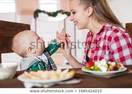 Menina sessão próprio jantar vestir tristeza Foto stock © IS2