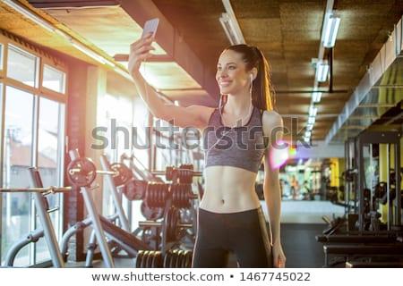 Stock fotó: Lányok · képzés · tornaterem · kettő · mosolyog · fitnessz