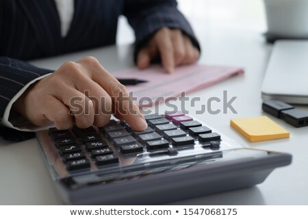 Accounting Calculating Cost Economic on office table Stock photo © adamr