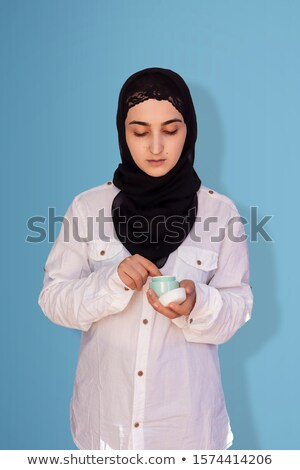Portrait closeup of muslim fashion woman 20s in religious headsc Stock photo © deandrobot