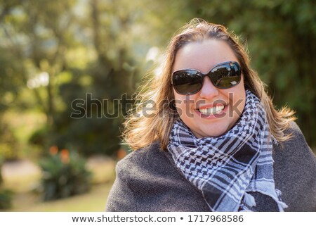 portrait of blonde woman wearing a grey jacket with checkers Stock photo © feedough