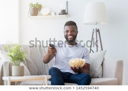 Uomo televisione remote ciotola popcorn Foto d'archivio © AndreyPopov