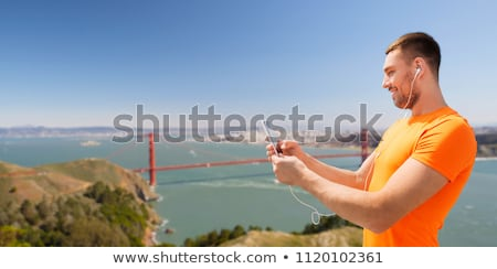 Homme smartphone golden gate fitness sport Photo stock © dolgachov