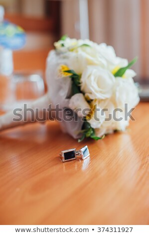Bridal bouquet of roses on planks with male studs Stock photo © ruslanshramko
