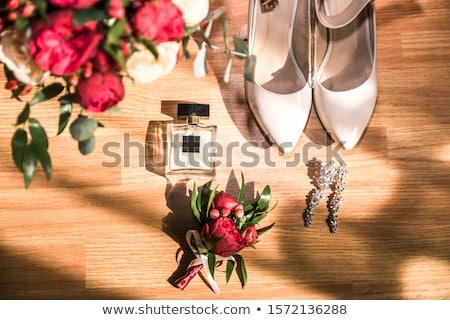wedding bouquet and bridesmaid shoes on brown mat Stock photo © ruslanshramko