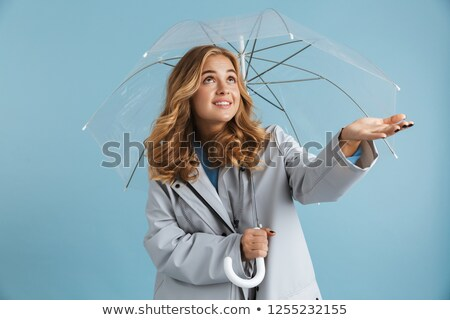 Stockfoto: Image Of Caucasian Woman 20s Wearing Raincoat Smiling And Holdin