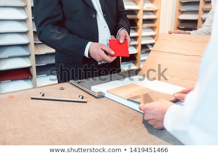 Kitchen expert showing people in his showroom materials and colors Stock photo © Kzenon
