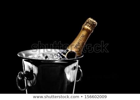 Champagne bouteille glace seau flûte verres Photo stock © karandaev