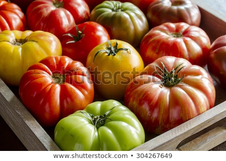 Wooden box filled with fresh vine ripened heirloom tomatoes from farmers market stock photo © Virgin