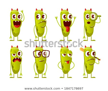 smiling horned green monster cartoon character holding happy halloween sign stock photo © hittoon