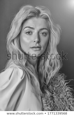 Portrait of wonderful young blonde woman with long hair looking at camera, smiling Stock photo © studiolucky