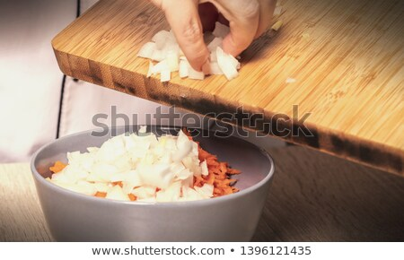Cipolle carote chef ciotola legno lavoro Foto d'archivio © OleksandrO