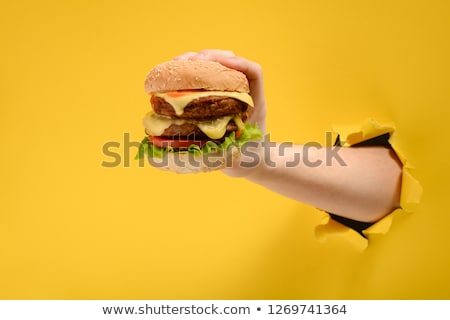 hands holding a burger fast food restaurant stock photo © studiostoks