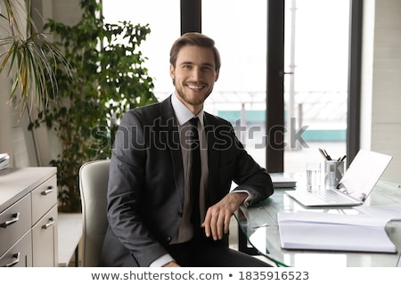 Image of executive director man in formal wear sitting on table  Stock photo © deandrobot