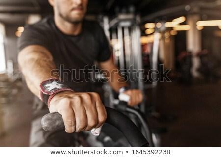 Man in Gym Using Stationary Bike Bodybuilding Stock photo © robuart
