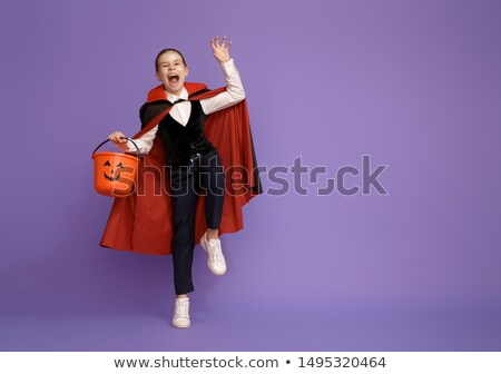 Stock photo: little Dracula with a basket