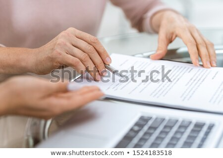 hand of mature woman pointing at one of contract points stock photo © pressmaster