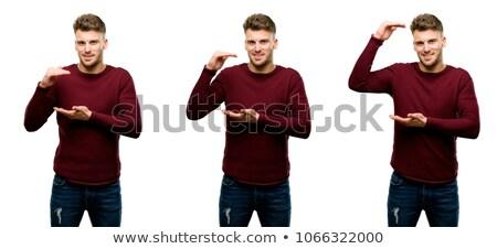 smiling young man showing size of something Stock photo © dolgachov