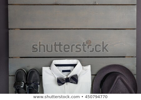 Men's outfit on wooden background. Kids fashion clothes. Grey fedora, navy pant, white shirt, black  Stock photo © Illia