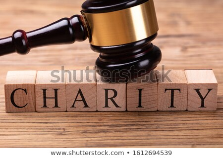 Gavel Over Word Charity On Textured Wooden Plank Stock photo © AndreyPopov